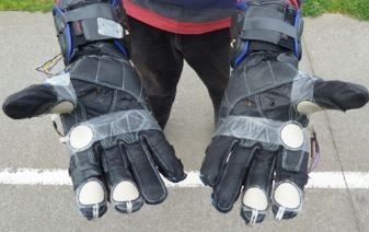 This initial prototype shows the FlexiForce A401 sensors attached to the outside of the gloves. (1)