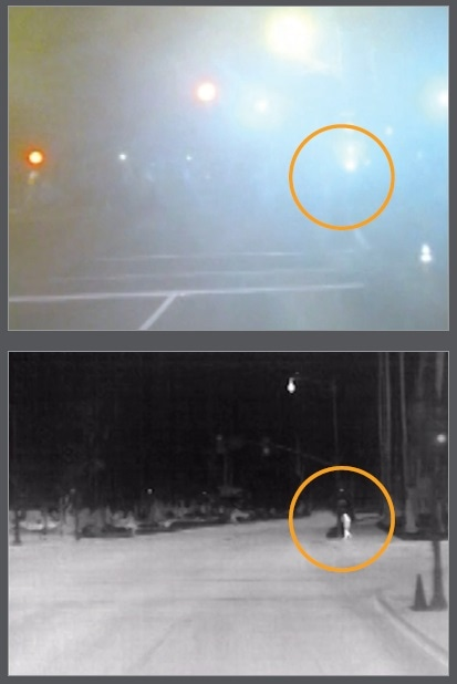 In this visible (top) and thermal (bottom) comparison, the glare of the streetlights and the nighttime fog make the pedestrian all but invisible in visible light but easily distinguished in thermal.