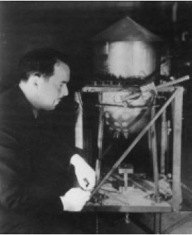 Arthur Claude Ruge, the inventor of the strain gage, working on his measurements.