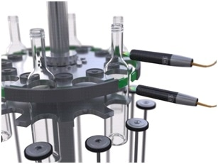 Inspection of wall thickness and roundness of the bottles during glass production.